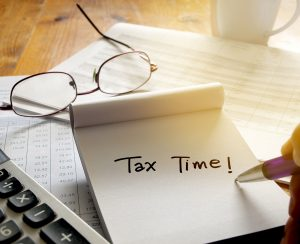 Image of paper reading Tax Time, article about taxes