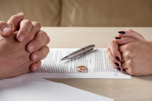 couples rings on divorce document