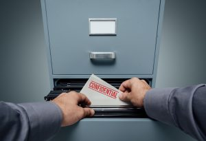 """file cabinet with """"Confidential"""" folder"""